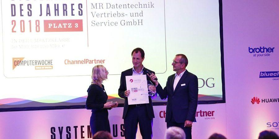 Übergabe Urkunde Systemhaus des Jahres 2018 MR